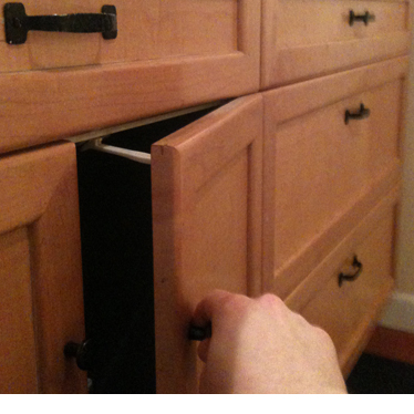 A cabinet with childproof latch