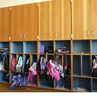A wall of storage cabinets for kids and adults