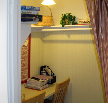 A small room with desk and chair for studying or working