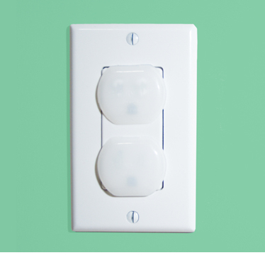 A wall socket with caps to prevent children from injuring themselves.