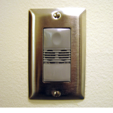 A light switch with an integrated occupancy sensor to turn off lights when the room is empty.