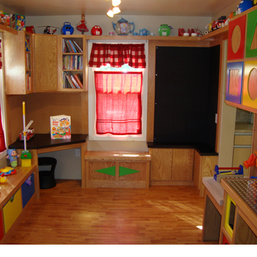 A kid-sized play area adjacent to a kitchen