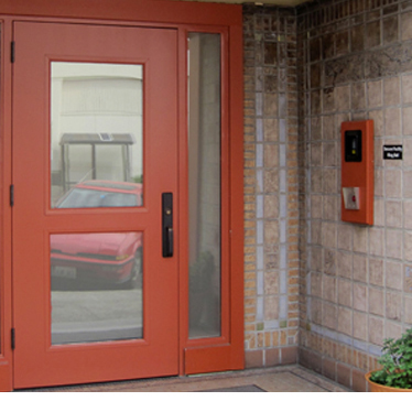 An entry door with intercom and card access
