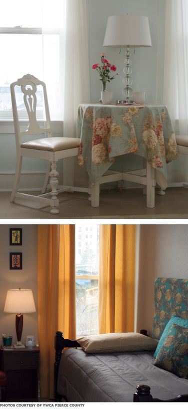 Two photos of the YWCA Pierce County. Top: A small round table with an ornate chair and lamp. Bottom: A daybed next to a window with long curtains.